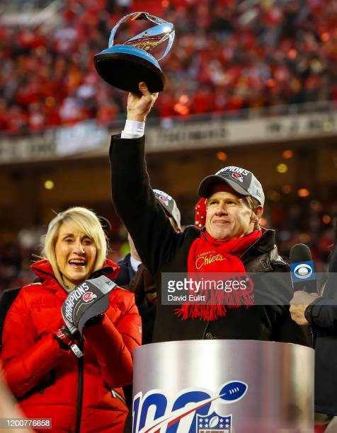 Kansas City Chiefs owner and CEO Clark Hunt holds up the Lamar Hunt trophy with his mother Norma Hunt widow of the Chiefs founder Lamar Hunt after...