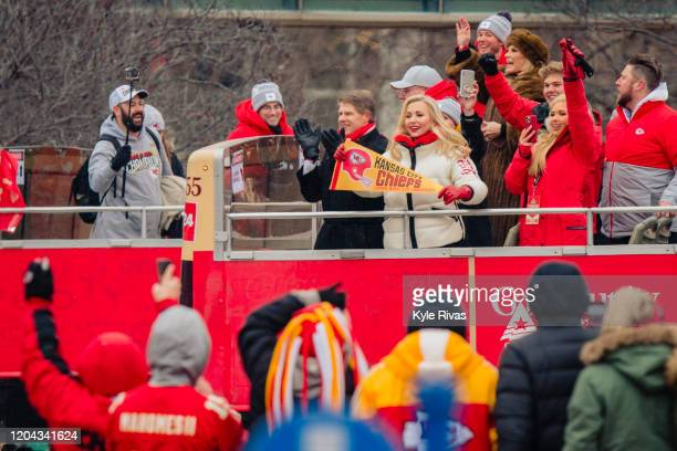 Kansas City Chiefs owner Clark Hunt and his wife Tavia Shackles wave at fans during the Kansas City Chiefs Victory Parade on February 5 2020 in...