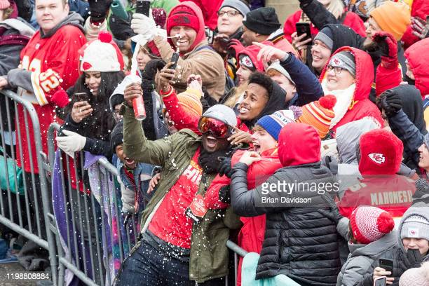 Kansas City Chiefs player celebrates with the crowd during the Kansas City Super Bowl Parade on February 5 2020 in Kansas City Missouri