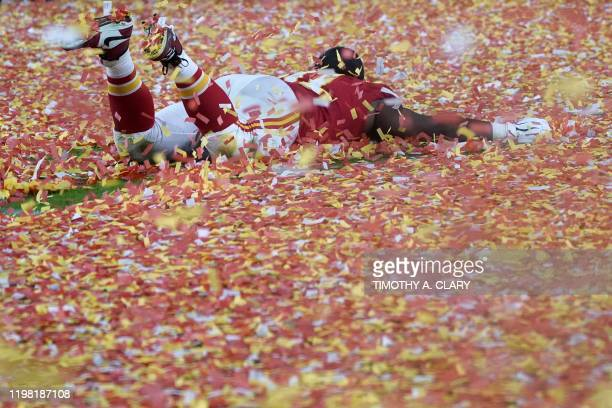 Kansas City Chiefs player slides in confetti on the pitch after winning Super Bowl LIV against the San Francisco 49ers at Hard Rock Stadium in Miami...