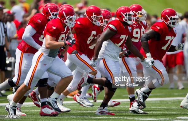 Kansas City Chiefs players begin their warmup run prior to Family Fun Day at the team's summer training camp at Missouri Western State University in...