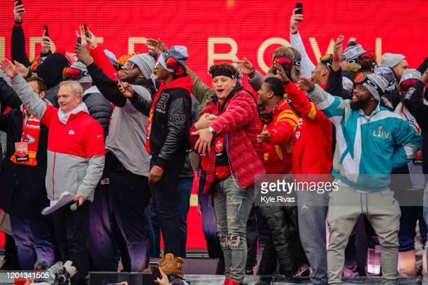 Kansas City Chiefs players do the tomahawk chop during the Kansas City Chiefs Victory Parade on February 5 2020 in Kansas City Missouri