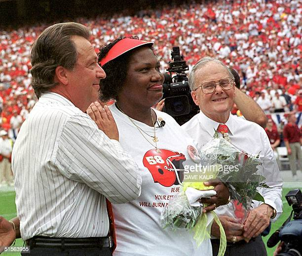 Kansas City Chiefs' president and general manager Carl Peterson and Chiefs' owner Lamar Hunt stand with Edith Morgan mother of Derrick Thomas who...