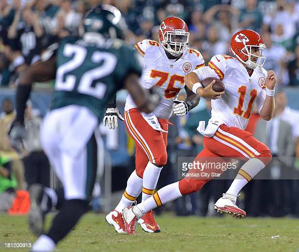 Kansas City Chiefs quarterback Alex Smith caries the ball in the first quarter against the Philadelphia Eagles at Lincoln Financial Field in...