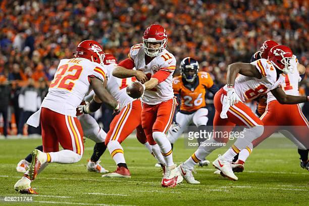 Kansas City Chiefs quarterback Alex Smith hands the ball to Kansas City Chiefs running back Spencer Ware during a game between the Denver Broncos and...