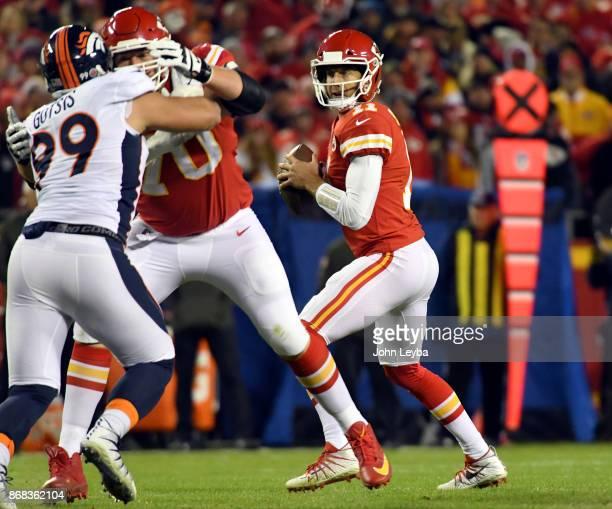 Kansas City Chiefs quarterback Alex Smith looks downfield to throw a pass agains the Denver Broncos on October 30 2017 in Kansas City MO at Arrowhead...