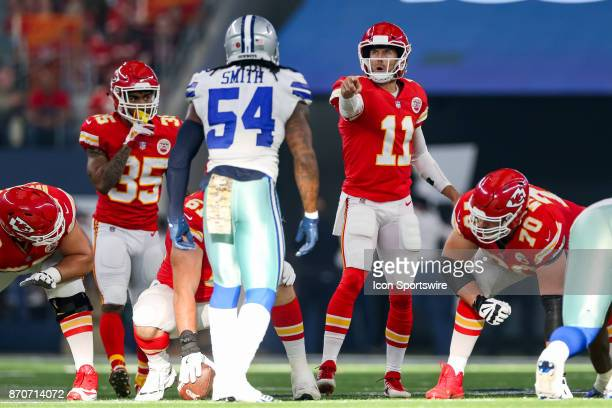 Kansas City Chiefs quarterback Alex Smith points out the blocking signals while watching the play clock during the NFL game between the Kansas City...
