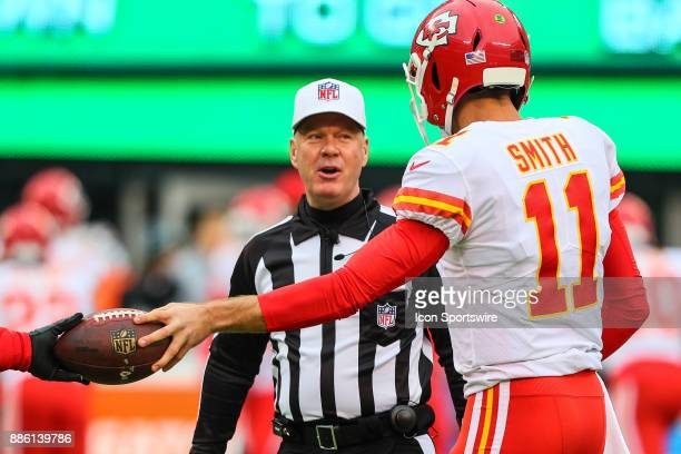 Kansas City Chiefs quarterback Alex Smith talks with referee John Parry prior to the National Football League game between the New York Jets and the...