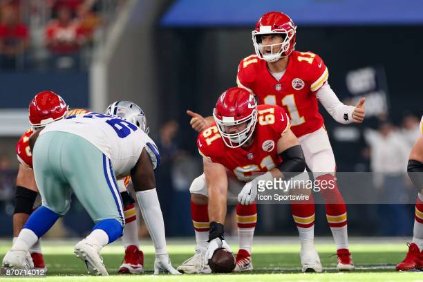 Kansas City Chiefs quarterback Alex Smith watches the clock as he makes calls at the line of scrimmage during the NFL game between the Kansas City...