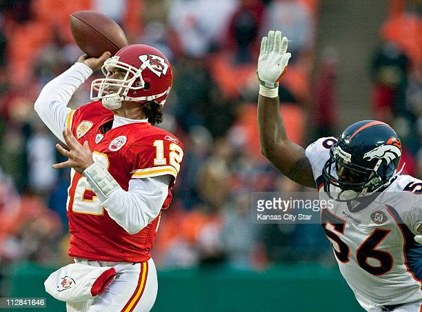 Kansas City Chiefs quarterback Brodie Croyle throws an incomplete pass under pressure from Denver Broncos defensive end Robert Ayers in the fourth...