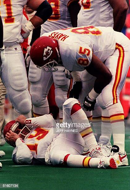 Kansas City Chiefs quarterback Joe Montana holds his head after being sacked 23 January 1994 during the AFC Championship game Montana who was sacked...