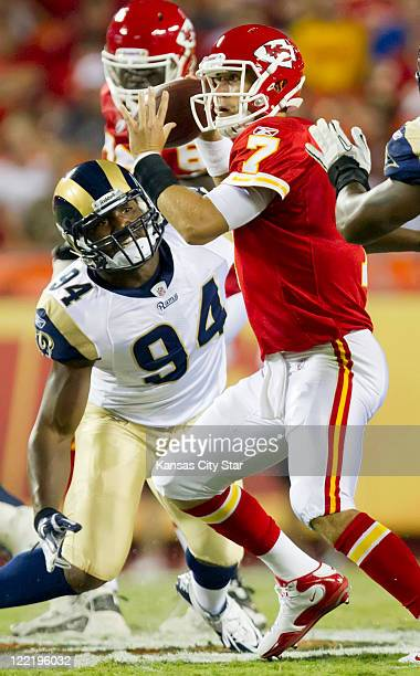 Kansas City Chiefs quarterback Matt Cassel avoids the defensive pressure from St Louis Rams defensive end Robert Quinn left during preseason action...