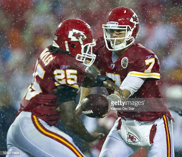 Kansas City Chiefs quarterback Matt Cassel hands off to running back Jamaal Charles in the third quarter of a NFL game against the San Diego Chargers...