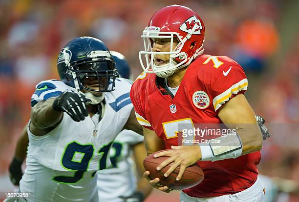 Kansas City Chiefs quarterback Matt Cassel is pulled down for a sack by Seattle Seahawks defensive end Chris Clemons in the first quarter in NFL...