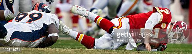 Kansas City Chiefs quarterback Matt Cassel loses three yards as he is sacked by Denver Broncos defensive end Vonnie Holliday in the third quarter The...