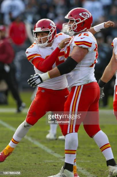 Kansas City Chiefs quarterback Patrick Mahomes and Eric Fisher celebrate a touchdown against the Oakland Raiders at the Oakland Alameda Coliseum in...