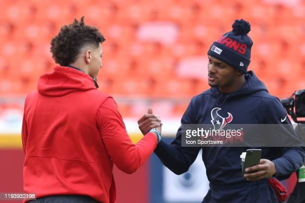 Kansas City Chiefs quarterback Patrick Mahomes and Houston Texans quarterback Deshaun Watson shake hands before an NFL Divisional round playoff game...