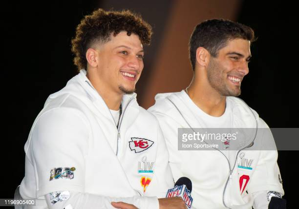 Kansas City Chiefs Quarterback Patrick Mahomes and San Francisco 49ers Quarterback Jimmy Garoppolo smile during the NFL Super Bowl Opening Night at...