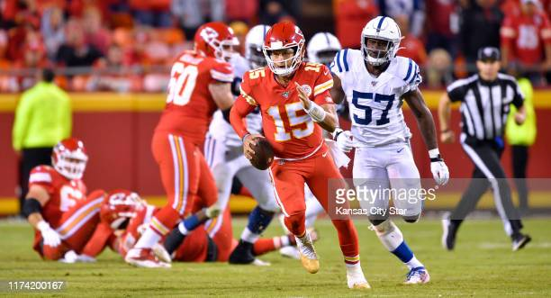 Kansas City Chiefs quarterback Patrick Mahomes breaks lose for a first down as Indianapolis Colts defensive end Kemoko Turay chases in the fourth...
