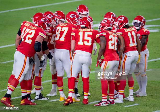 Kansas City Chiefs Quarterback Patrick Mahomes calls a play in the huddle with Kansas City Chiefs Offensive Tackle Eric Fisher Kansas City Chiefs...