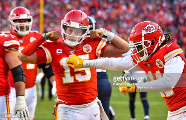 Kansas City Chiefs quarterback Patrick Mahomes celebrates his 27-yard touchdown run late in the second quarter against the Tennessee Titans during...