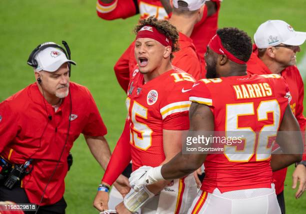 Kansas City Chiefs Quarterback Patrick Mahomes celebrates scoring a touchdown with Kansas City Chiefs Defensive End Demone Harris on the sidelines...