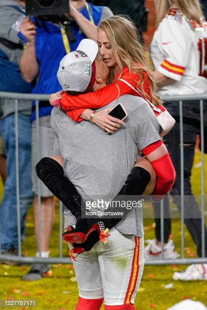 Kansas City Chiefs quarterback Patrick Mahomes celebrates with girlfriend and high school sweetheart Brittany Matthews after game action during the...