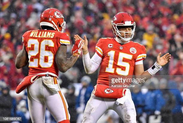 Kansas City Chiefs quarterback Patrick Mahomes celebrates with running back Damien Williams after Mahomes scored on a dive into the end zone late in...