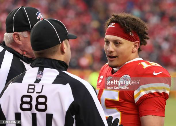 Kansas City Chiefs quarterback Patrick Mahomes complains to the referees about a taunting call on running back Damien Williams after a touchdown run...