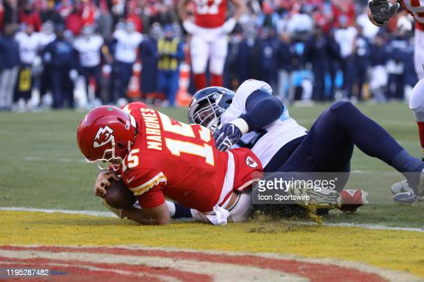 Kansas City Chiefs quarterback Patrick Mahomes crosses the goal line at the end of a 27yard touchdown run with 011 seconds left in the second quarter...