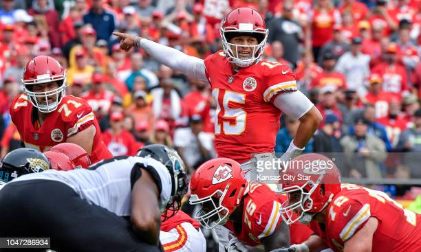 Kansas City Chiefs quarterback Patrick Mahomes directs the offense in the third quarter during Sunday's football game against the Jacksonville...
