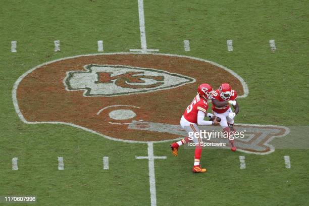 Kansas City Chiefs quarterback Patrick Mahomes fakes a handoff to running back LeSean McCoy in the third quarter of an AFC matchup between the...