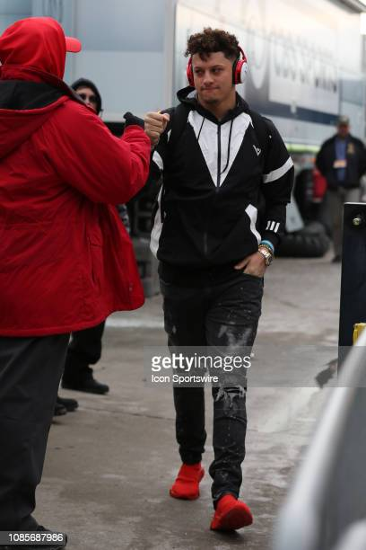 Kansas City Chiefs quarterback Patrick Mahomes fist bumps a security guard as he walks into the stadium before the AFC Championship Game game between...