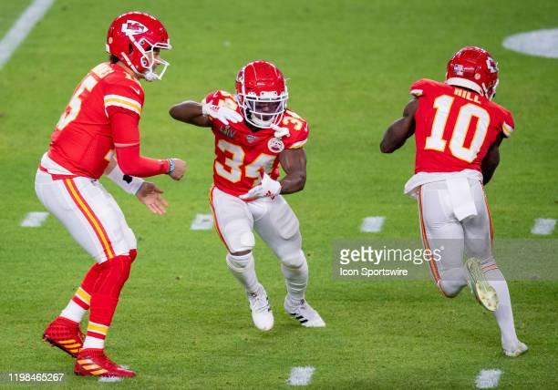 Kansas City Chiefs Quarterback Patrick Mahomes hands off the ball to Kansas City Chiefs Wide Receiver Tyreek Hill as Kansas City Chiefs Running Back...