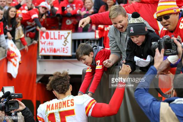 Kansas City Chiefs quarterback Patrick Mahomes highfives some excited young fans in the stands as he leaves the field following the National Football...