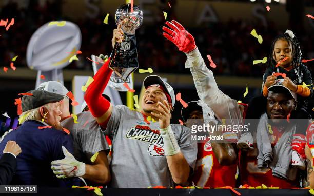 Kansas City Chiefs quarterback Patrick Mahomes holds the Vince Lombardi Trophy after winning Super Bowl LIV against the San Francisco 49ers, 31-20,...