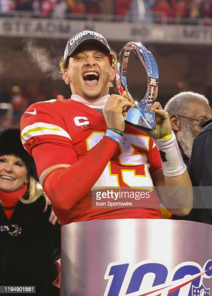 Kansas City Chiefs quarterback Patrick Mahomes is all smiles with the Lamar Hunt Trophy after the AFC Championship game between the Tennessee Titans...