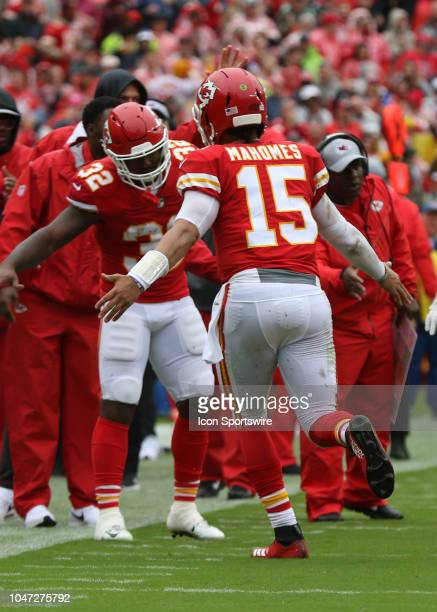 Kansas City Chiefs quarterback Patrick Mahomes is congratulated by running back Spencer Ware after Mahomes 4yard touchdown run in the first quarter...