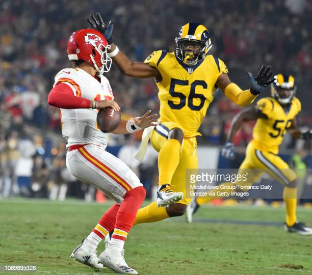 Kansas City Chiefs quarterback Patrick Mahomes is pressured by Los Angeles Rams defensive end Dante Fowler at the Los Angeles Memorial Coliseum on...