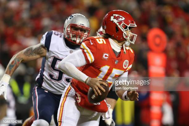 Kansas City Chiefs quarterback Patrick Mahomes is pressured by New England Patriots outside linebacker John Simon in the second quarter of the AFC...