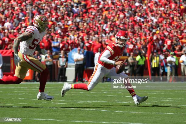 Kansas City Chiefs quarterback Patrick Mahomes is pursued by San Francisco 49ers defensive end Cassius Marsh before changing direction in the second...