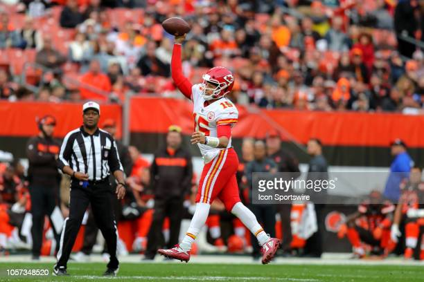 Kansas City Chiefs quarterback Patrick Mahomes leaps as he throws a pass during the fourth quarter of the National Football League game between the...