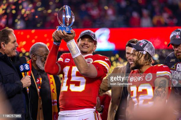 Kansas City Chiefs quarterback Patrick Mahomes lifts the championship trophy after winning against the Tennessee Titans at Arrowhead Stadium in...