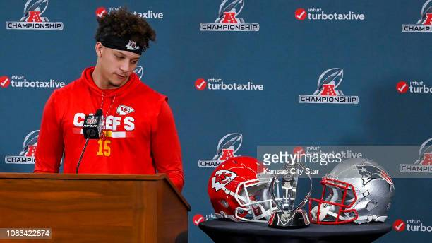 Kansas City Chiefs quarterback Patrick Mahomes looks at the Lamar Hunt Trophy during a news conference in Kansas City Mo on Wednesday Jan 16 ahead of...