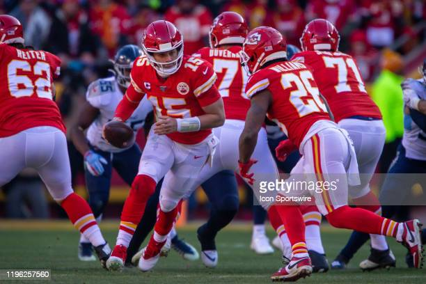 Kansas City Chiefs quarterback Patrick Mahomes looks to hand off the ball to Kansas City Chiefs running back Damien Williams against the Tennessee...