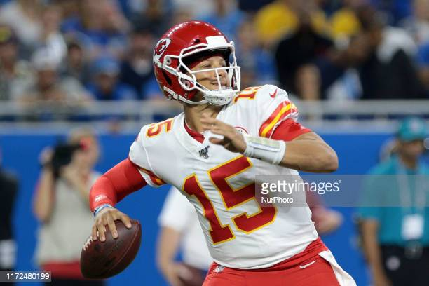 Kansas City Chiefs quarterback Patrick Mahomes looks to pass during the first half of an NFL football game against the Detroit Lions in Detroit...
