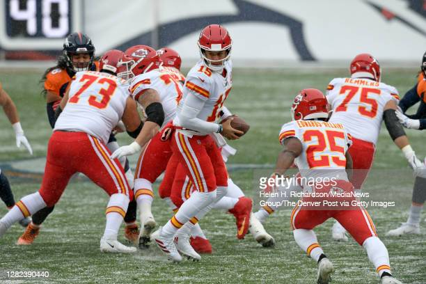 Kansas City Chiefs quarterback Patrick Mahomes looks to pass the ball to running back Clyde EdwardsHelaire #25 right during the first quarter as they...