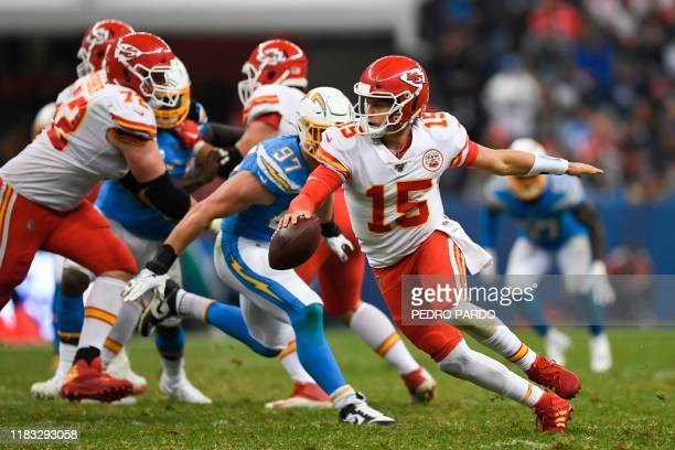 Kansas City Chiefs quarterback Patrick Mahomes looks to throw a pass during the 2019 NFL week 11 regular season football game between Kansas City...