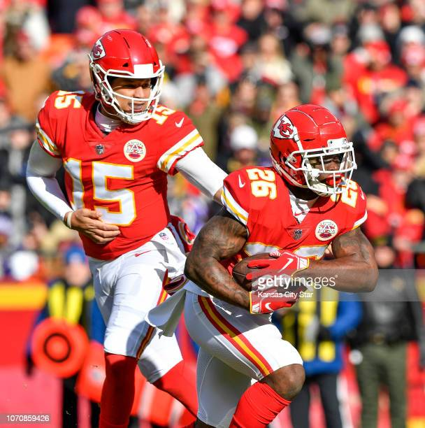 Kansas City Chiefs quarterback Patrick Mahomes makes a handoff to running back Damien Williams to make a oneyard run for a touchdown in the first...
