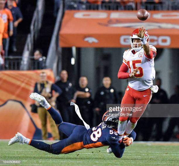 Kansas City Chiefs quarterback Patrick Mahomes makes a left handed first down pass to wide receiver Tyreek Hill as Denver Broncos linebacker Von...